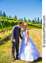 Bride and Groom Romantic Kiss - A bride and groom share a...