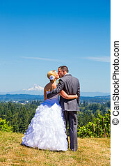 Bride and Groom with Fabulous View - A bride and groom enjoy...