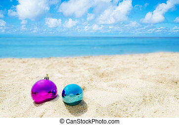 Two Christmas balls on the beach - holiday concept - Two...