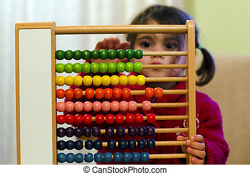 Chinese calculator - Little girl learns to count and...