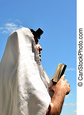 Jewish man pray - Jewish man wearing Tallit and Tefillin...