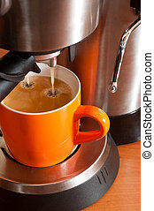 Coffee cup in the percolator - Orange coffee cup in the...