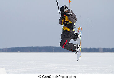 Snow kiting on a snowboard