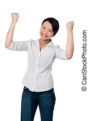 Excited charming girl with clenched fists - Attractive asian...