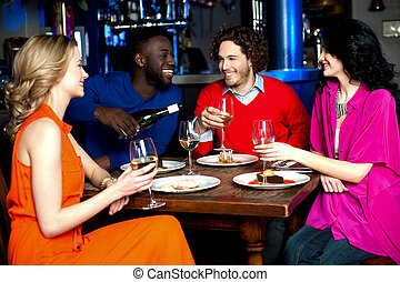 Young couples enjoying their dinner with drinks - Group of...