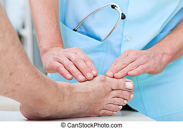 Orthopaedist at work - Orthopedist at work checking patients...