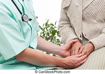 Doctors help - Doctor keeping an elderly patients hands