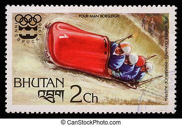 BHUTAN - CIRCA 1976: A stmp printed in Bhutan shows four man...