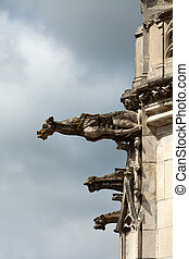 old gargoyles on the wall of the castle in Amboise