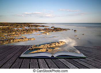 Creative concept pages of book Landscape image of rocky beach at susnet with long exposure motion blur sea