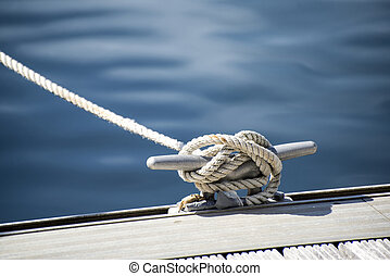 Detail image of yacht rope cleat on sailboat deck - Yacht...