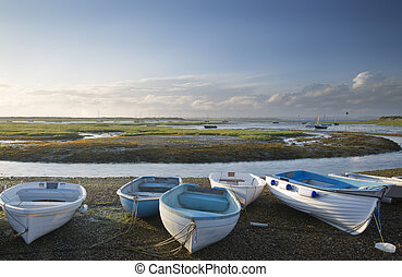Small leisure boats moored at low tide in marina at Summer...