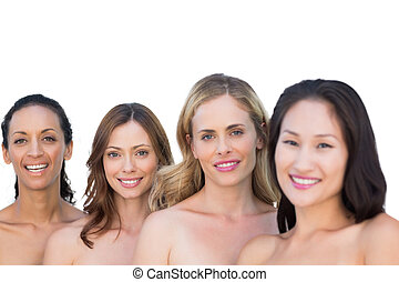 Smiling nude models on white background posing in a line...