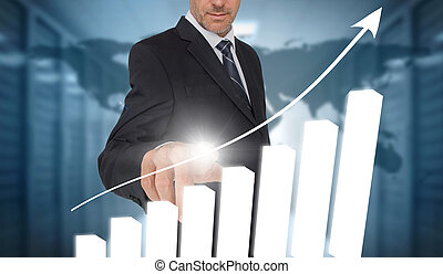 Businessman touching bar chart interface with world map on...