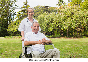 Man sitting in a wheelchair with hi