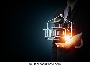 The house in human hands, insurance concept