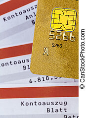 credit card and bank statement - a gold credit card and bank...