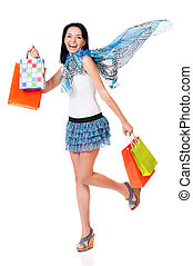 Woman shopping - Cheerful smiling woman with shopping bags,...