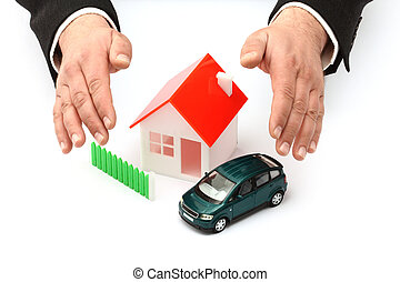 Real property or insurance concept - Hands, car and house...