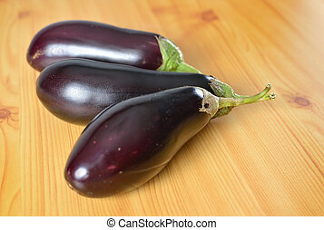 Three organic ripe purple eggplant