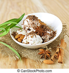 Delicious nut ice cream scoops with cinnamon and chocolate