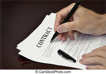 Signing Contract - Business man signing contract with black...