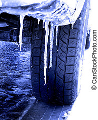 Tire Driving in Snow and Ice - Snowy winter road with tire...