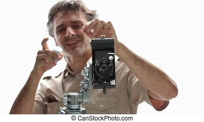 retro photographer - happy photographer with old retro...