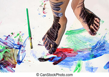 Painted Kid's Feet on Art Project - a young child's feet are...