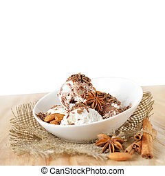 Food background Scoops of ice cream with nuts and chocolate