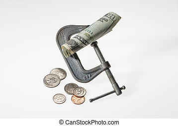Money squeeze - Vise squeezing money as a concept or...