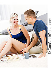 Attractive woman and her boy friend in the living room talking.