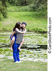 Lady Kissing her Lover in Front Pond