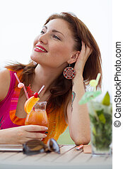 Sexy young woman drinking coctail