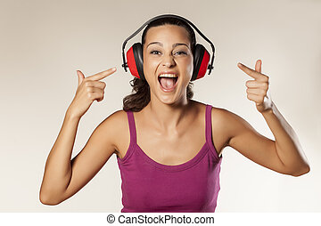 Anti-noise headset - beautiful happy young brunette can not...