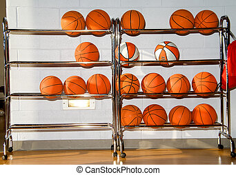 Basketballs - A series of collegiate type basletballs on a...