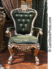 antique chair upholstered in velvet in the interior of the...
