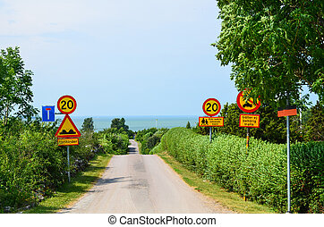 Road signs - Lot of road signs at a road to the beach