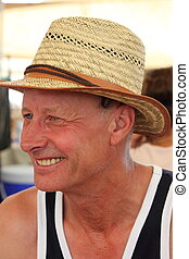 Mature englishman - A mature white male smiling and wearing...