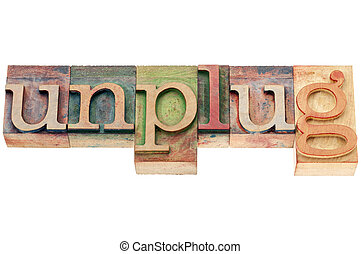 unplug word in wood type - unplug - lifestyle or information...