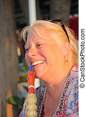smoking a hookah water pipe - Lady smoking a hookah water...