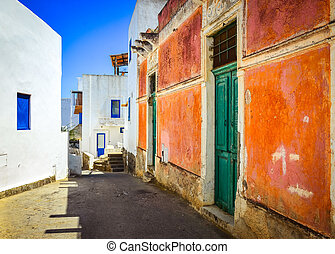 Mediterranean street with colorful walls and doors and...