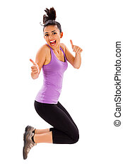 Fitness is My Life - Cute girl laughing and jumping while...