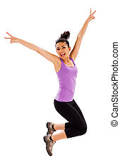 Fitness - Beautiful fit young lady jumping enjoying her...