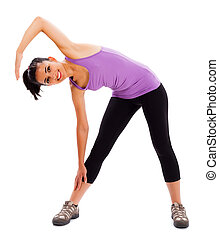 Fitness Begins - Fit brunette woman showing how to keep fit...