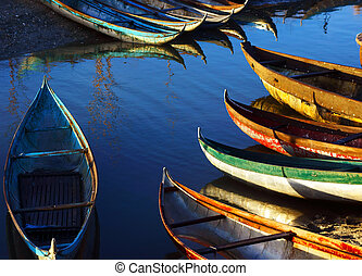 Beautiful scene with small craft under golden light - in...