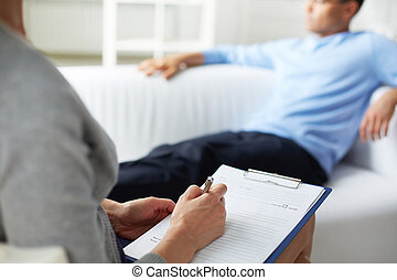 Psychological consultation - Female psychologist making...
