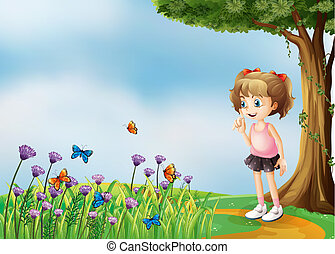 A small girl above the hill with a garden