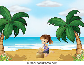 A young girl forming a sand castle at the beach -...