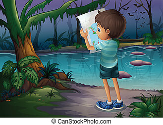 A boy with a map standing in the middle of the forest -...